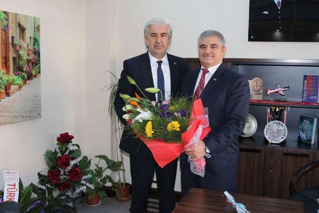 Belediye Başkanı Salih Hızlı, Milli Eğitim Müdürü Mermer'i ziyaret etti