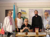 Ukrayna Fahri Konsolosu Güvercin'den, Ferdi Deren'e başarı belgesi