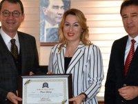 Lokantacılar Oda Başkanı Güney'e onur belgesi