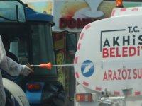 Akhisar'da boş kalan sokaklar belediye ekiplerince dezenfekte edildi